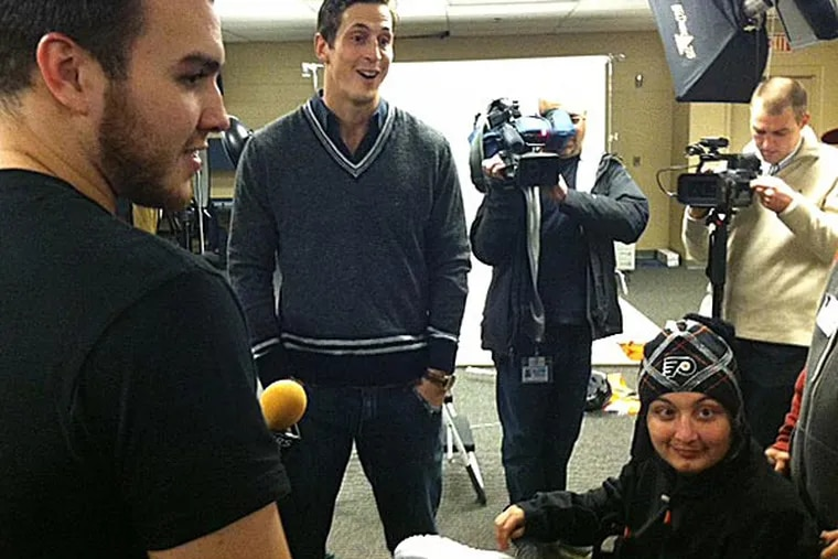 The Flyers' Zac Rinaldo and Vinny Lecavalier share a light moment with Jose Toledo, a 17 year-old from Northeast Philadelphia who is battling brain cancer. (Photo by Sam Carchidi)