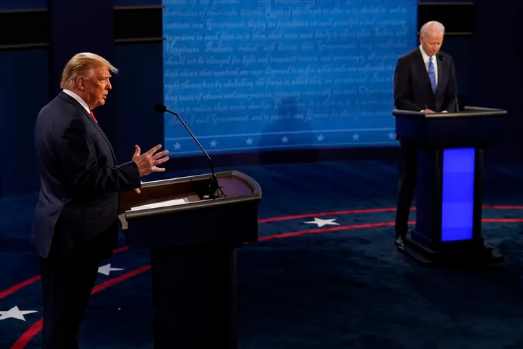 President Donald Trump answers a question as Democratic presidential candidate former Vice President Joe Biden takes notes during the second and final presidential debate Thursday at Belmont University in Nashville, Tenn.