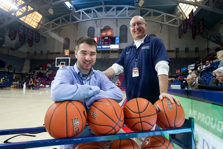 Drexel public address announcer Jeff Asch (right), and his son, Temple radio analyst David Asch, both worked at the Temple-Drexel basketball game at the Palestra on Dec. 22.