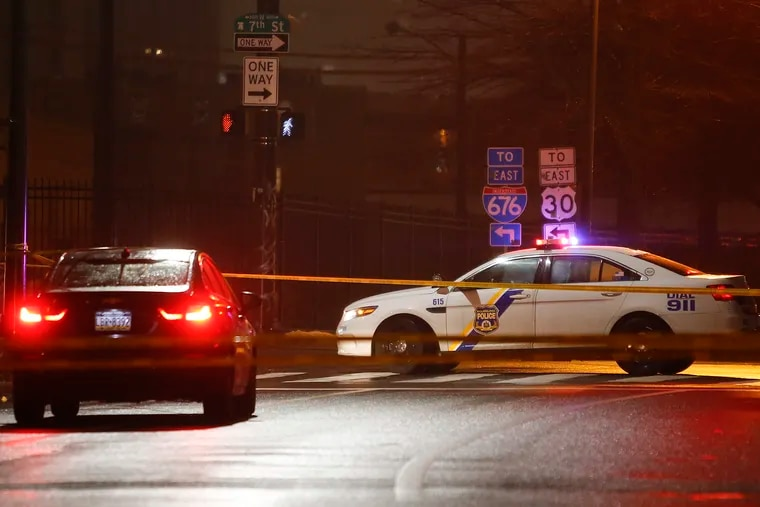 A Philadelphia Police cruiser sits at the intersection of 7th and Callowhill Streets after a white male was shot twice in the head on Monday. The male was transported to Temple University Hospital and listed in critical condition.