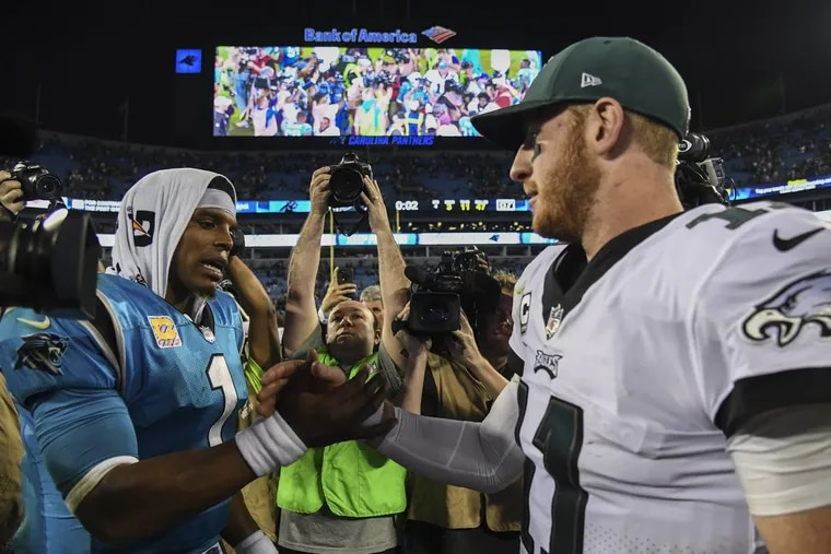 Eagles quarterback Carson Wentz greets Panthers quarterback Cam Newton after the Eagles beat the Panthers 28-23 at Bank of America Stadium October 12, 2017.