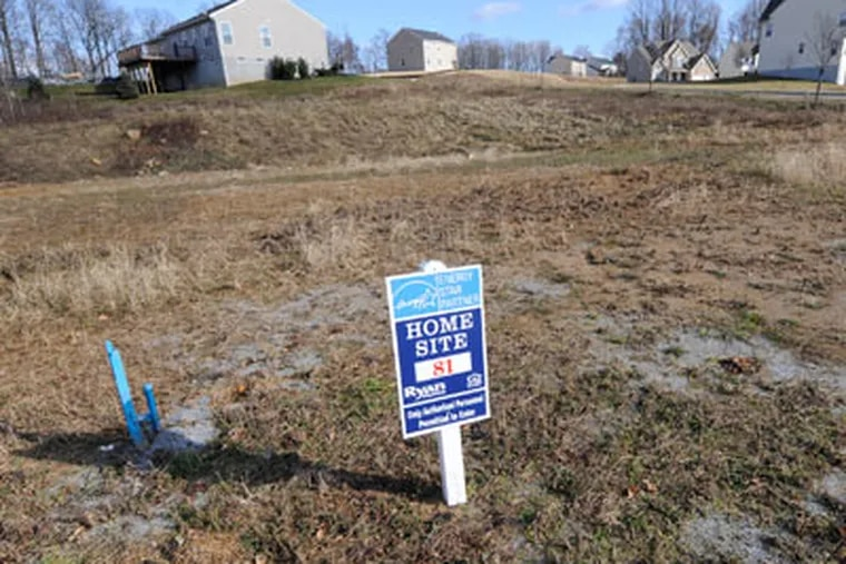 In Ryan Homes' Oakcrest development in Coatesville, there are plenty of empty lots waiting for homes to be built. (Clem Murray / Staff Photographer)