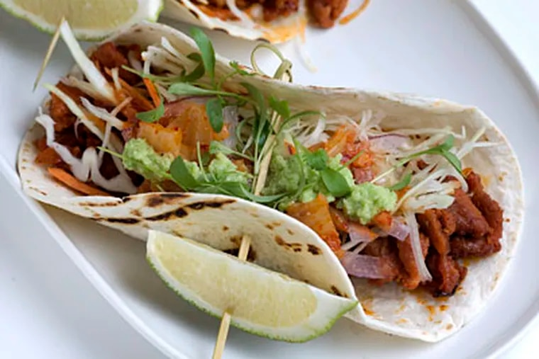 Korean tacos, like this pork variety at Doma, showed up all over town. (ED HILLE / Staff Photographer)