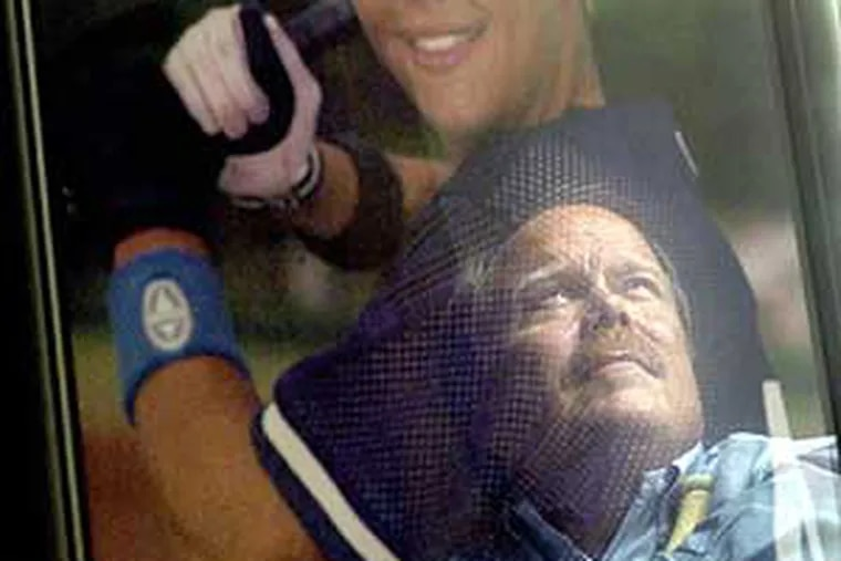 Don Hooton is reflected in a portrait of his son Taylor, who turned to steroids after a coach told him he needed to get bigger. The elder Hooton has taken his battle against the drugs to the Internet and the halls of Congress.