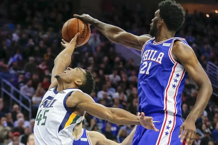 Utah Jazz guard Donovan Mitchell gets blocked by Sixers center Joel Embiid on Monday.