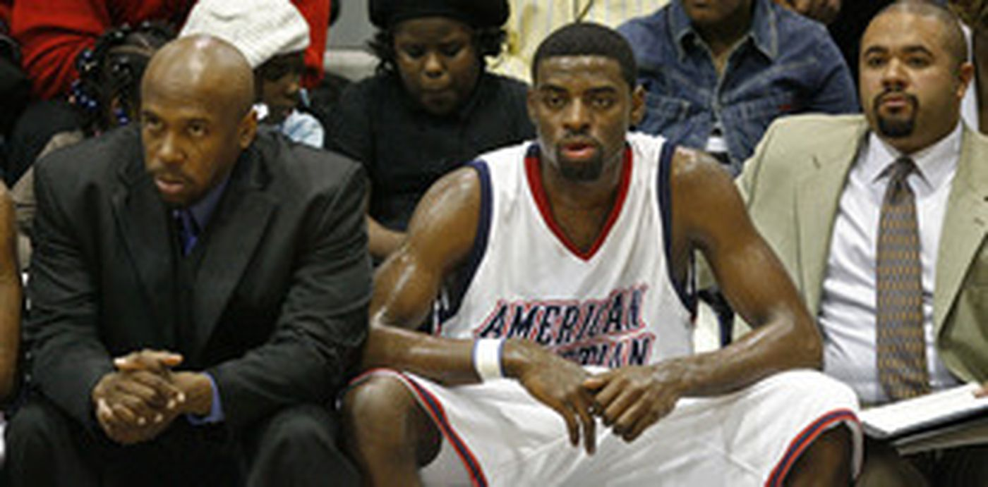 Tyreke Evans sits on the bench during American Christian's game against Atlantic City last night at a tournament at Widener University. Security was heavy around the player and in the arena.