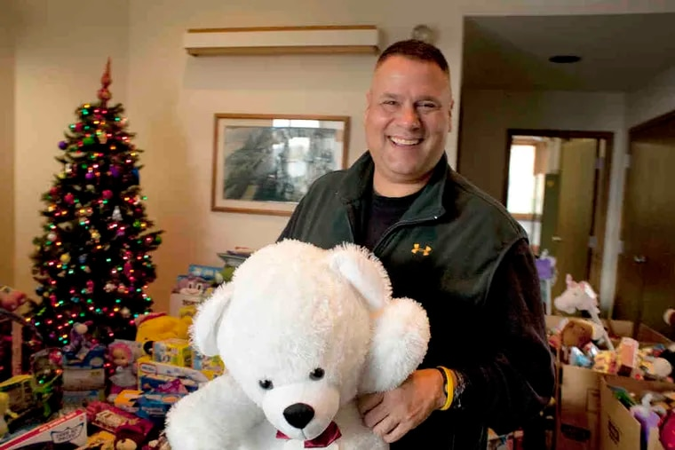 West Caln Police Chief Curt Martinez with the donated toys that fill the lobby of the township building. Martinez said his department began Toys for Tots collections when he became chief in 2007. An official for the national campaign said donations were down this year.