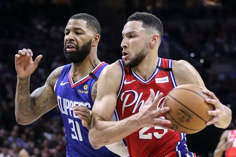 Sixers' Ben Simmons drives on Clippers' Marcus Morris Sr. during the 2nd quarter at the Wells Fargo Center in Philadelphia in February.