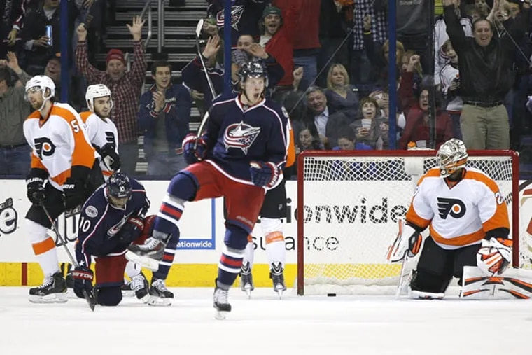 Blue Jackets' Ryan Johansen (19) celebrates a goal against Philadelphia Flyers goalie Ray Emery (29) during the first period of an NHL hockey game on Saturday, Dec. 21, 2013, in Columbus, Ohio. (Mike Munden/AP)