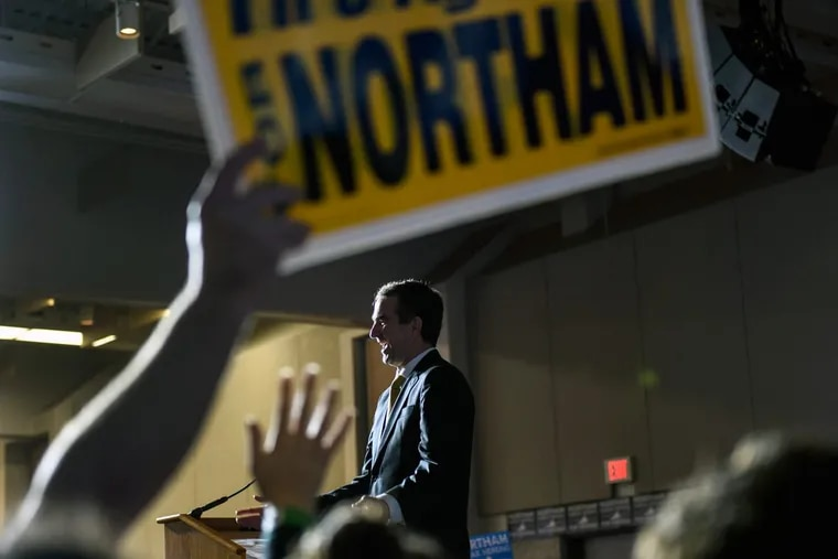 Democrat Ralph Northam takes the stage after winning the gubernatorial race in Virginia. Northam greets his supporters at George Mason University in Fairfax. Many are looking at the Virginia race as being a harbinger of what to expect in the midterm elections of 2018.