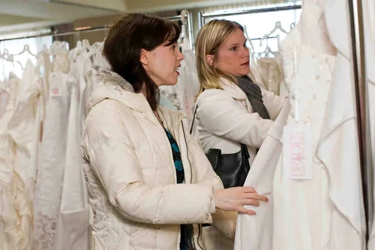 Wedding-gown shoppers look for deals at the Brides Against Breast Cancer tour stop in Raleigh, N.C. The tour, which offers new and used wedding dresses in 40 cities, comes this week to Ramada Philadelphia Airport hotel.