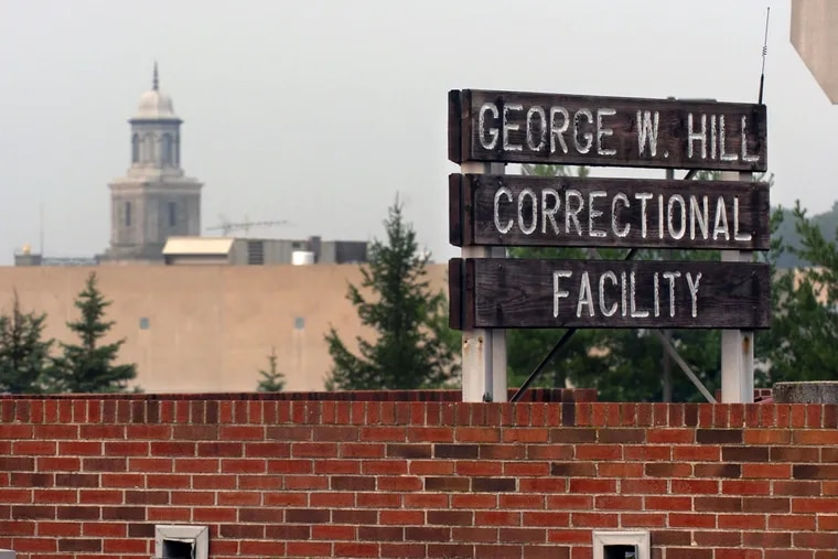 A guard at the George W. Hill Correctional Facility helped an inmate smuggle Subxone into the facility, authorities say.