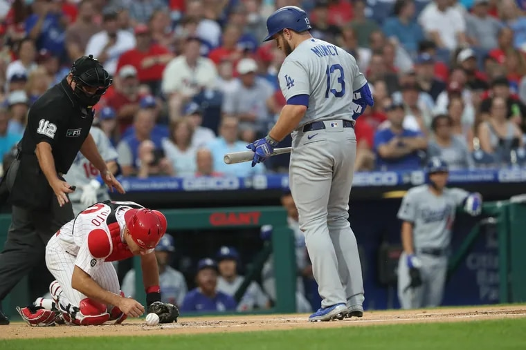 Phillies catcher J.T. Realmuto was hit by a foul ball by Max Muncy of the Dodgers in the first inning Wednesday night. He later left the game.