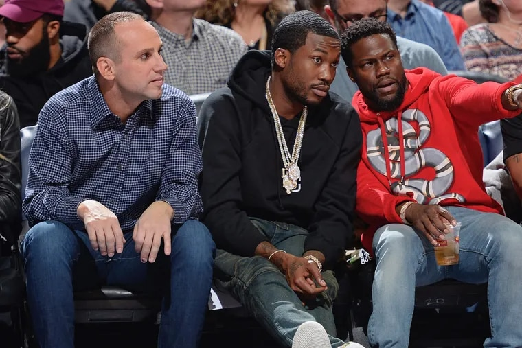Michael Rubin (left) at a Philadelphia 76ers game with Meek Mill (center) and actor Kevin Hart.