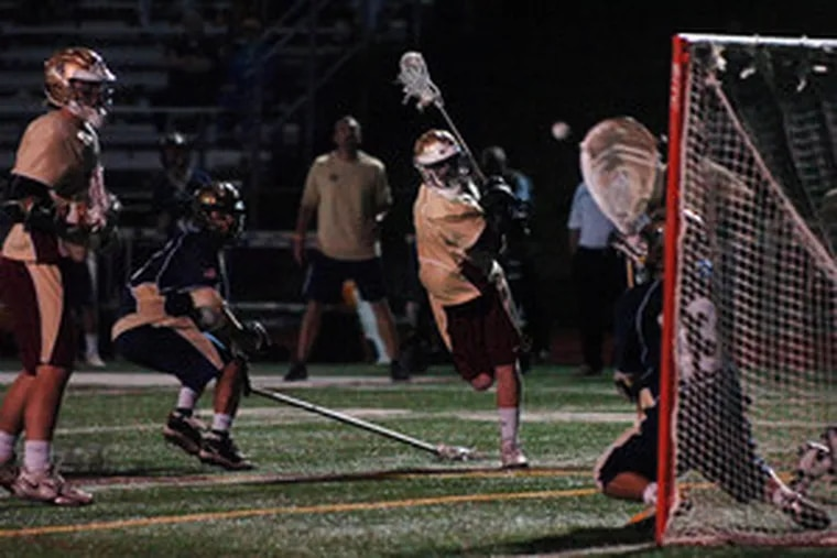 Haverford School's Rory O'Connor takes a shot against La Salle goalie Niko Amato. O'Connor scored a game-high four goals for the third-seeded Fords, but the second-seeded Explorers scored with one-tenth of second left in the second overtime to win.