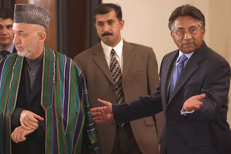 Pakistan's President Pervez Musharraf (right) and Afghan leader Hamid Karzai. Both countries face Islamist threats.