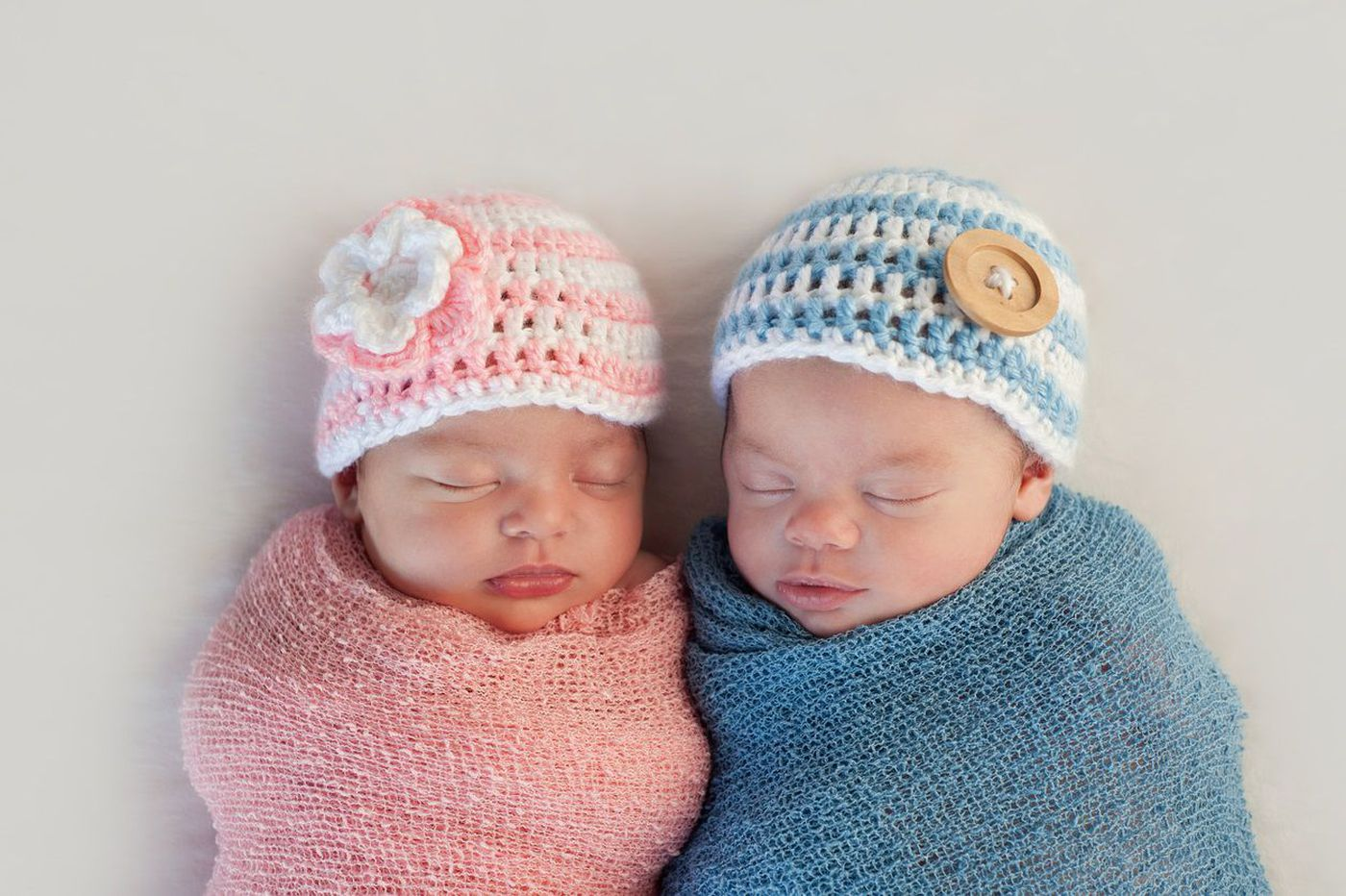 For twins, gender inequities may start in the womb, a new study finds