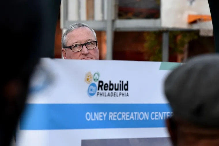 """Mayor Kenney waits to speak at the Olney Recreation Center as he visits three parks and recreation centers Sept. 30, 2021, on what was billed a """"first-ever Rebuild Philadelphia Groundbreaking Tour,"""" kicking off over $20 million in projects moving into construction."""