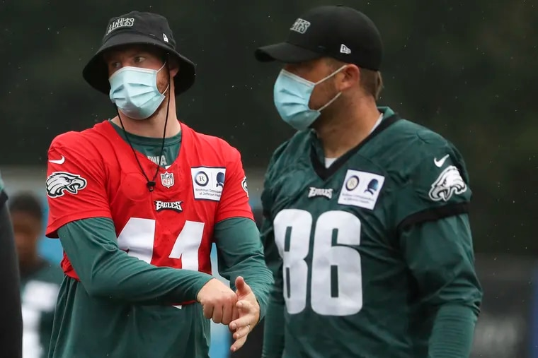 Eagles quarterback Carson Wentz (left) and tight end Zach Ertz talked Wednesday with teammate Rodney McLeod about social justice issues.