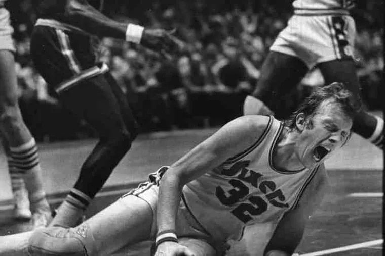 Billy Cunningham reacting to the 1975 injury that cost him his playing career. The photograph won many honors.