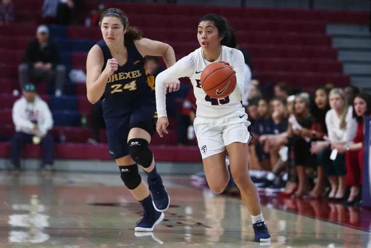 Penn women's basketball point guard Kayla Padilla (right) is averaging over 19 points per game this season.
