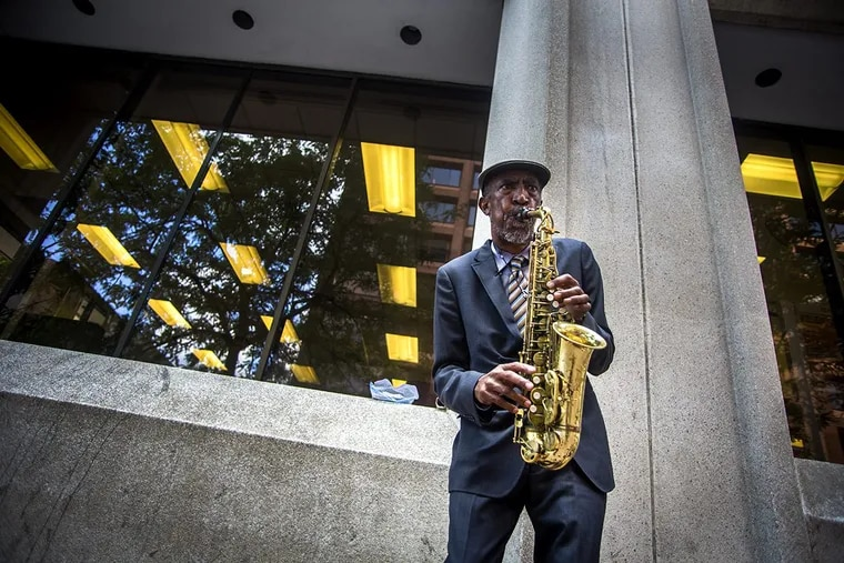 David Puryear plays the alto sax on Market and 4th streets in Center City.