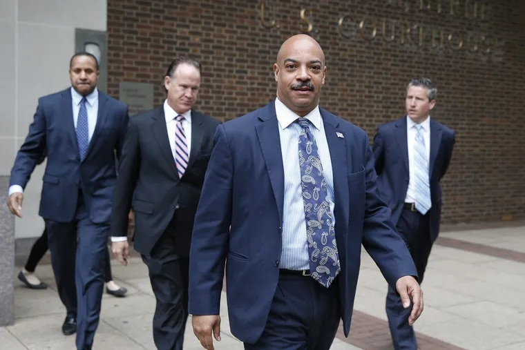 Seth Williams, center, May 11, 2017, at federal court in Philadelphia, PA.