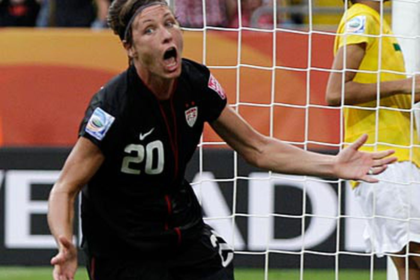 Wambach's late goal sets up historic win