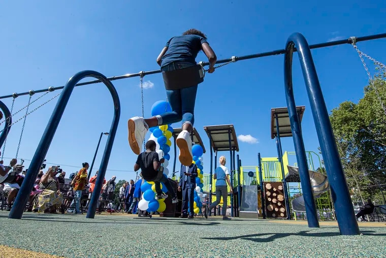 Kids play in the new Williams Moore Reed Memorial Park in North Philadelphia, named in honor of Keisha Williams and her three children, who were struck and killed by a carjacked vehicle in 2014 while running a fruit stand to raise money for a new playground at their church.