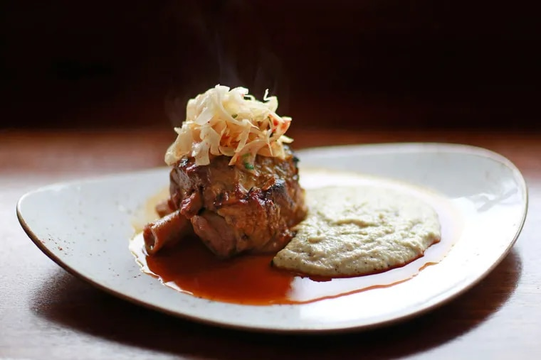 Slow-braised pork shank over buckwheat polenta enriched with taleggio at A Mano.