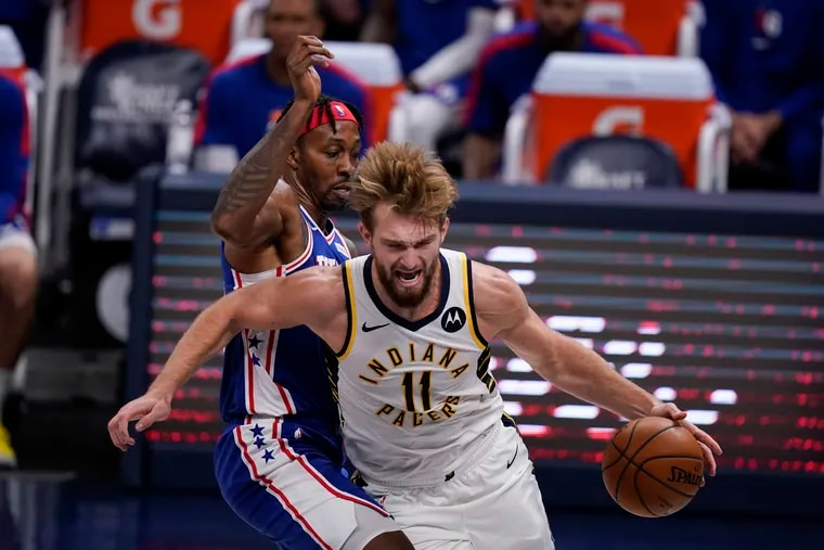 The Pacers' Domantas Sabonis (11) drives to the basket against the Sixers' Dwight Howard (39) during the second half of Friday night's preseason finale.