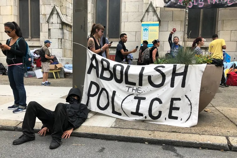 Members of Occupy ICE gather along N. Broad St. at Arch St. in Center City Philadelphia on Tuesday, July 31, 2018. Police are trying to remove their encampment. DAVID SWANSON / Staff Photographer