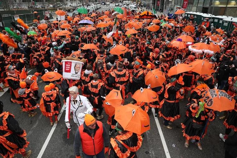 Members of Froggy Carr gather at 16th and JFK during the Mummers Parade in Philadelphia, PA on January1, 2020.
