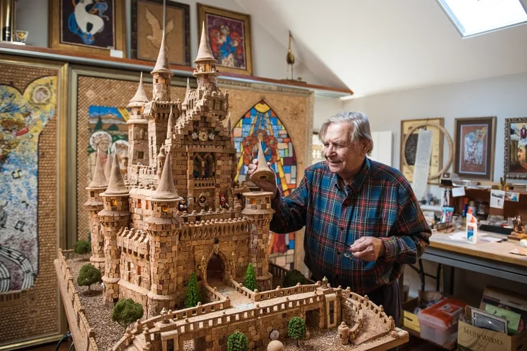 Huntingdon Valley's Walter Deuschle inspects his 40-inch-high, 56-inch-wide replica of Disney World's Cinderella Castle, constructed from 7,300 corks.