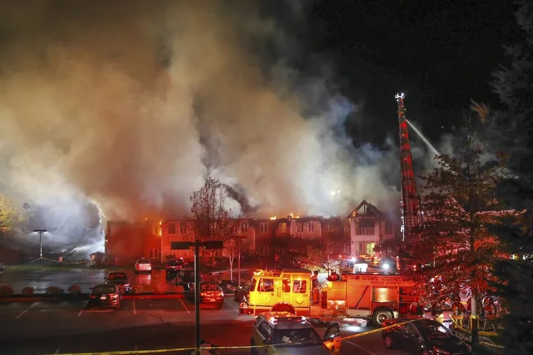 Firefighters battle a four-alarm blaze at the Barclay Friends nursing home in West Chester on Nov. 16.