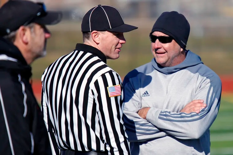 Phil Gormley (right), the acting athletic director and former football coach at Northeast High School, is worried that the 2020 fall season may not get underway at all due to logistical challenges.