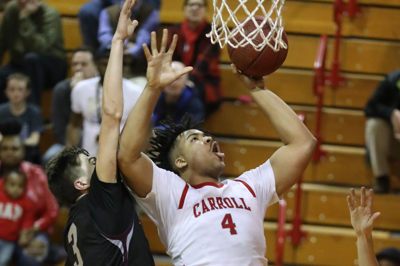 Archbishop Carroll's Tairi Ketner proudly carries his famous father's basketball legacy
