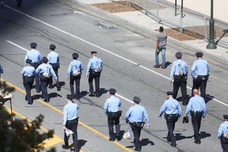 Philadelphia police walk the Benjamin Franklin Parkway in advance of Pope Francis' visit. The police were part of a security effort that also included the FBI and other federal investigative and law-enforcement agencies.