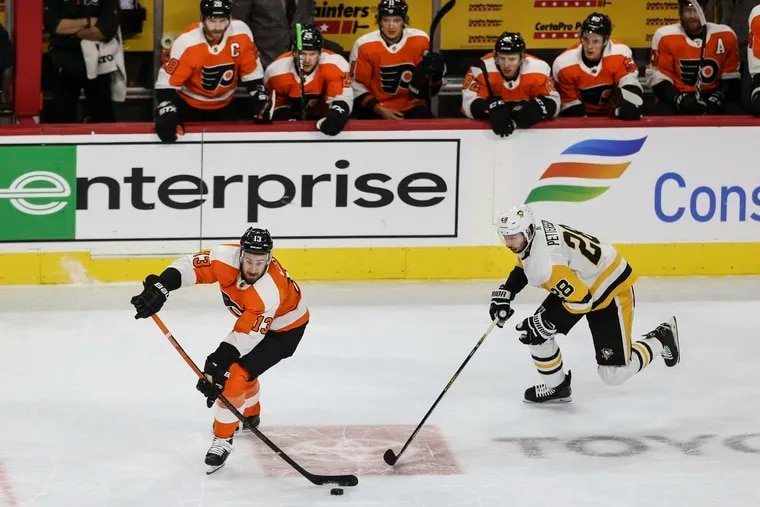 Flyers center Kevin Hayes makes a pass in front of the Penguins' Marcus Pettersson last season. Hayes is looking forward to playing eight regular-season games against division rivals in 2021, assuming a 56-game schedule is approved.