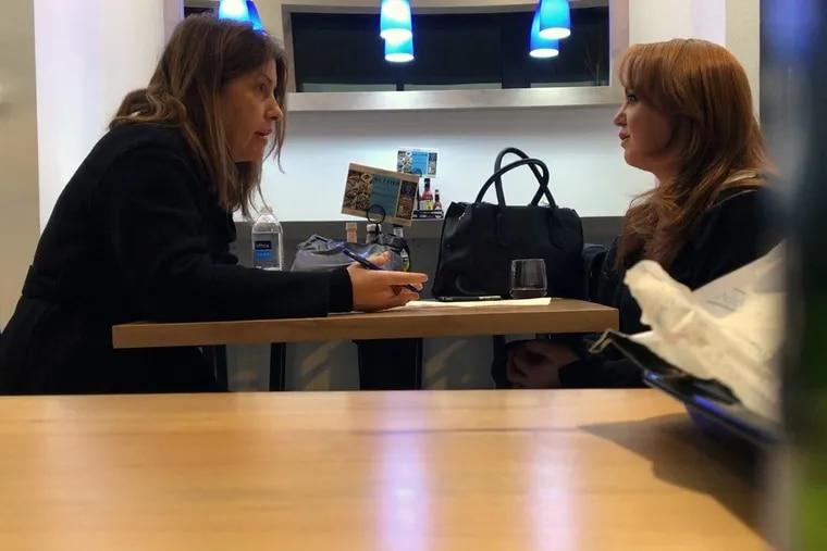 Washington Post reporter Stephanie McCrummen (left) interviews Jaime T. Phillips at a Greek restaurant in Alexandria, Va., on Wednesday.