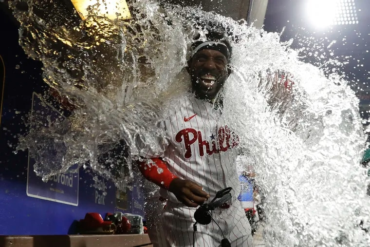 Phillies Andrew McCutchen gets the water bath after hitting the game winning walk-off three run home run against the Washington Nationals on Monday, July 26, 2021 in Philadelphia.