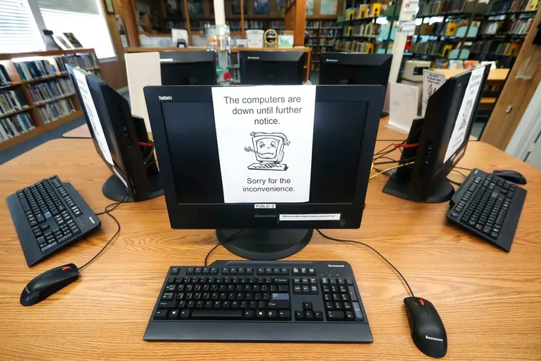 Signs on a bank of computers tell visitors that the machines are not working at the public library in Wilmer, Texas. Cyberattacks that recently crippled nearly two dozen Texas cities have put other local governments on guard.