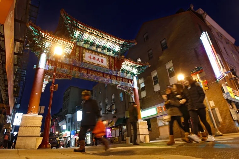 The Chinese Friendship Gate is the focal point of Chinatown where new restaurants are changing the look of the venerable Chinese community. ( MICHAEL BRYANT / Staff Photographer )