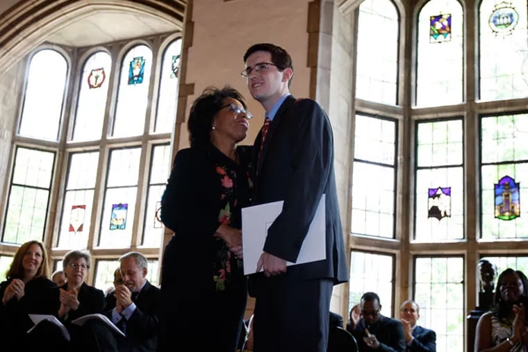 JoAnne Epps, dean of the Temple Law School, with Anthony Foltz, who was honored in 2011 for overcoming adversity. Epps, who became dean in 2008, has guided the school through some challenging times. (DAVID MAIALETTI/Staff Photographer)