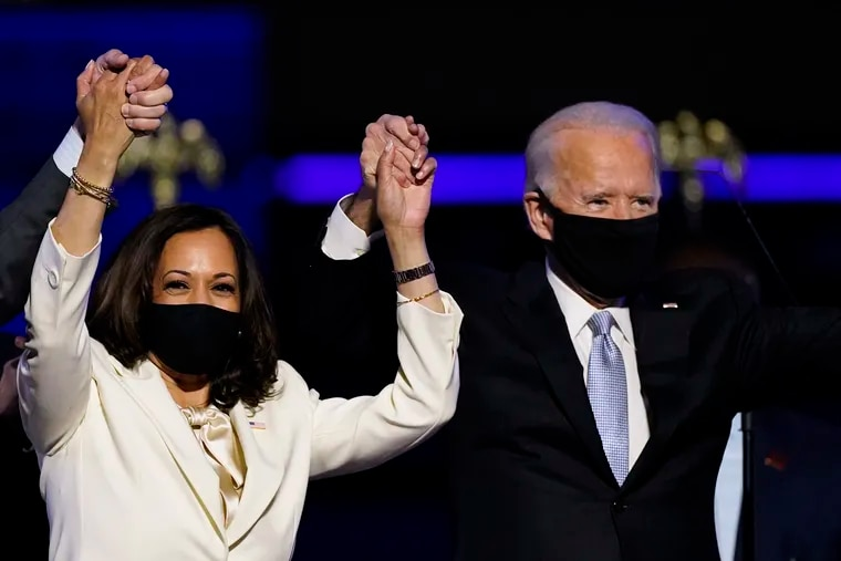 In this Nov. 7 photo, Vice President-elect Kamala Harris (left) holds hands with President-elect Joe Biden.