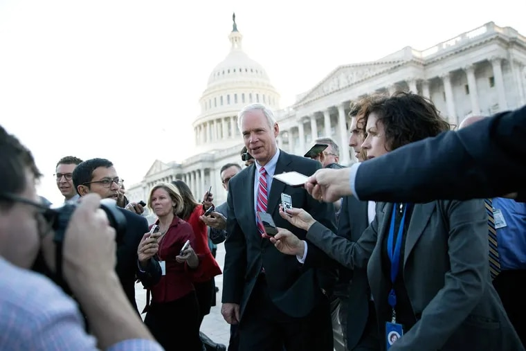 Sen. Ron Johnson (R., Wis), is surrounded by media as he walks from the Capitol building on Capitol Hill in Washington  on Wednesday.