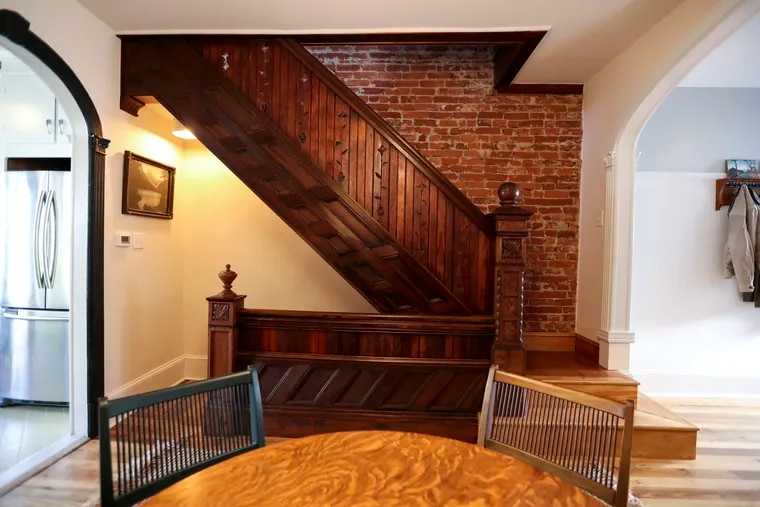"""The staircase of this South Philly rowhouse combines six different woods from 10 different buildings in what owner Dan Clark calls """"an ode to Frank Furness,"""" one of Philadelphia's most famous architects."""