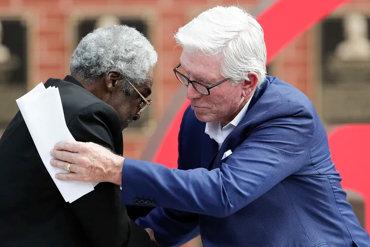 Former Phillies Dick Allen and Mike Schmidt embrace during a ceremony retiring Allen's number 15 before the Phillies play the Washington Nationals on Thursday, Sept. 3, 2020. Schmidt hopes the late Allen will soon be joining him in Cooperstown as a member of the Baseball Hall of Fame.