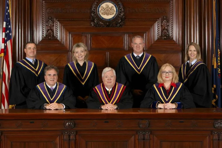 Pennsylvania Supreme Court justices, including Justice Kevin Dougherty, standing second from right.