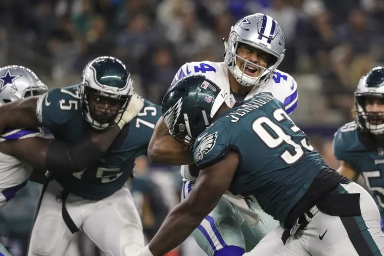 Eagles defensive tackle Tim Jernigan (right) and defensive end Vinny Curry get to Cowboys quarterback Dak Prescott in the 4th quarter of the game in Dallas November 19, 2017. DAVE MAIALETTI / Staff Photographer